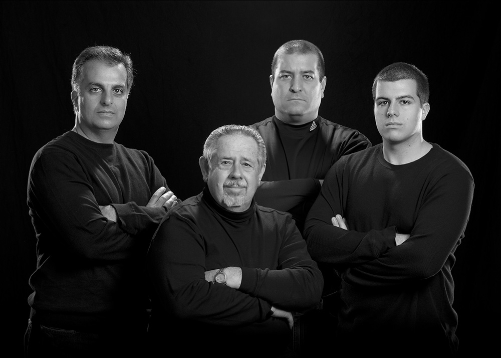 Created with raphaël group men pose black background louisville